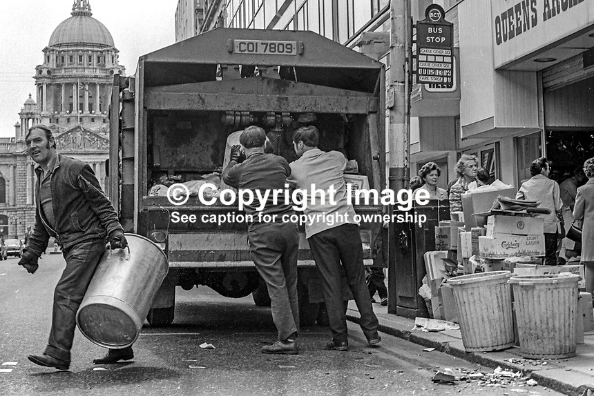 After the Ulster Workers' Council strike Belfast, N Ireland, gets back to work with binmen clearing a backlog of refuse. May 1974. 197405290298g<br />