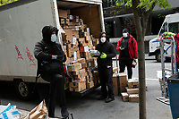 New York, New York City, during the time of the Coronavirus. Mean unloading mail and Amazon packages.
