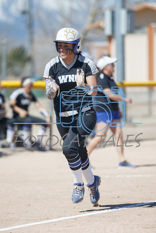 Western Nevada's Gabrielle Canibeyaz celebrates running home against Colorado North Western at Edmonds Sports Complex Carson City, Nev., on Friday, March 18, 2016.<br /> Photo by Jeff Mulvihill, Jr.