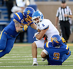 BROOKINGS, SD - SEPTEMBER 10:  Dallas Brown #15 and Anthony Washington #9 from South Dakota State bring down Keegan Gallery #2 from Drake during their game at the Dana J. Dykhouse Stadium Saturday night in Brookings. (Photo by Dave Eggen/Inertia)