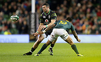 Saturday 11th November 2017; Ireland vs South Africa<br /> Robbie Henshaw passes inside as he is tackled by Elton Jantjies during the Guinness Autumn Series between Ireland and South Africa at the Aviva Stadium, Lansdowne Road, Dublin, Ireland.  Photo by DICKSONDIGITAL