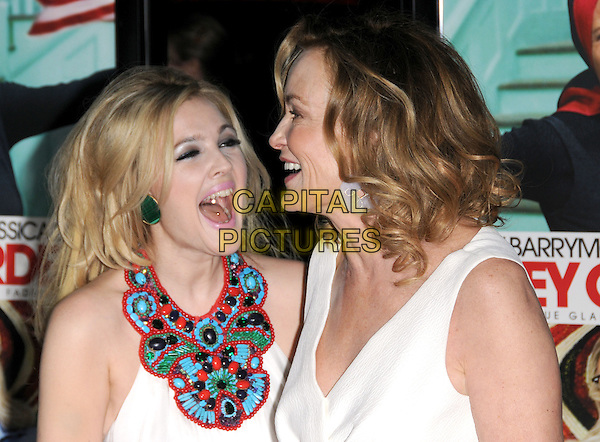 "DREW BARRYMORE & JESSICA LANGE.The HBO Screening of ""Grey Gardens"" held at The Grauman's Chinese Theatre in Hollywood, California, USA..April 16th, 2009 .headshot portrait profile pink lipstick big messy tousled teased hair green earrings white maxi red blue detail halterneck collar beads beaded top mouth open laughing tongue ring piercing laughing funny .CAP/DVS.©Debbie VanStory/Capital Pictures."