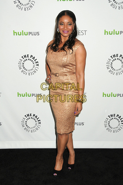 "Tamala Jones.PaleyFest 2012 Presents ""Castle"" held at The Saban Theatre, Beverly Hills, California, USA, 9th March 2012..full length gold dress hand on hip  belt  hand on hip black shoes peep toe .CAP/ADM/BP.©Byron Purvis/AdMedia/Capital Pictures."