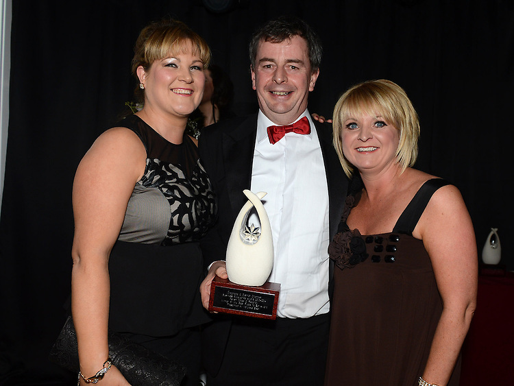Lisa Judge and Denise Walsh of Relish receive the Best Place To Eat award from Paddy Callaghan representing sponsor Natures Best at the Business Excellence Awards in Earth Night Club at the Westcourt Hotel. Photo:Colin Bell/pressphotos.ie