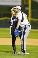 Elliott Sadler (11) of Team NASCAR (right) poses for a photo with Courtney Force (13) of Team NHRA at second base during the NASCAR vs NHRA Charity Softball Challenge at CMC-Northeast Stadium on April 17, 2013 in Kannapolis, North Carolina.  Team NHRA defeated Team NASCAR 19-5.  (Brian Westerholt/Four Seam Images)