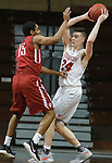 SIOUX FALLS, SD - MARCH 9:  Kyle Mangas #24 of Indiana Wesleyan looks to pass around the defense of David Burton #15 if IU Southeast at the 2018 NAIA DII Men's Basketball Championship at the Sanford Pentagon in Sioux Falls. (Photo by Dick Carlson/Inertia)