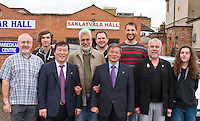 Ambassador to UK His Excellency Mr. Hyon Hak Bong of the Democratic People's Republic of Korea and Embassy official Myongsin Mun in Southall after attending a Saklatvala Hall Commemoration which celebrated the centenary of  Kim Il-sung's birth, posing with a number of comrades, Easter Sunday 2012