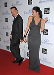 "Angie Harmon Sehorn & Tom Hanks at The Saks Fifth Avenue's ""Unforgettable Evening"" benefiting EIF's Women's Cancer Research Fund held at The Beverly Wilshire Hotel in Beverly Hills, California on February 10,2009                                                                     Copyright 2009 Debbie VanStory/RockinExposures"
