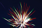 A burst of fireworks in the primary colors