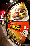 """McDonal's Japan launches a black burger called """"Ikasumi (Squid Ink) burger"""" and white burger """"Camembert Chicken Fireo"""" for Halloween season on October 4, 2014 in Tokyo Japan. The Ikasumi burger contains black sesame and squid ink on its buns, and fried onions, cheddar cheese, squid ink and chipotle sauce. The concept of the burger is """"what would happen if witch played a trick on the burger."""" The burgers are currently available at three branches in Tokyo's Shinjuku area: Shinjuku Minamiguchi, Seibu Shinjuku Station and Shinjuku Oguard Nishi and are priced at 370 JPY (3.35USD) and 670JPY (6.06USD) for the combo. McDonald's Japan announced on their official website that they will expand the sales to other stores from October 8. (Photo by Rodrigo Reyes Marin/AFLO)"""