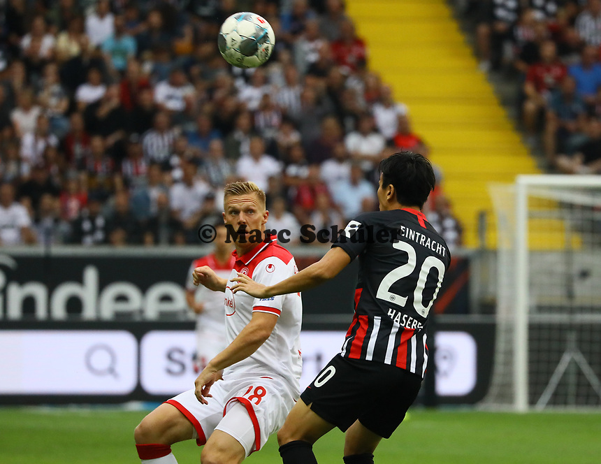Makoto Hasebe (Eintracht Frankfurt) gegen Rouwen Hennings (Fortuna Düsseldorf) - 01.09.2019: Eintracht Frankfurt vs. Fortuna Düsseldorf, Commerzbank Arena, 3. Spieltag<br /> DISCLAIMER: DFL regulations prohibit any use of photographs as image sequences and/or quasi-video.
