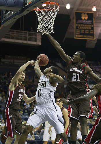 December 08, 2012:  Notre Dame guard Eric Atkins (0) and Brown forwards Cedric Kuakumensah (21) and Tucker Halpern (33) go up for the rebound during NCAA Basketball game action between the Notre Dame Fighting Irish and the Brown Bears at Purcell Pavilion at the Joyce Center in South Bend, Indiana.  Notre Dame defeated Brown 84-57.