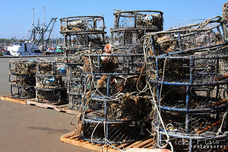 Crab pots are stacked on shore at the Crescent City Harbor in Crescent City, California. The crab season typically is between the months of December and July depending upon the species of crab. Photographed 07/08