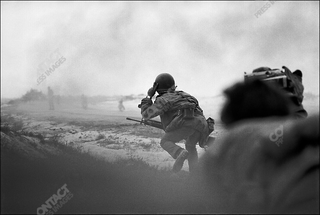 South Vietnamese soldier runs towards a concentration of North Vietnamese during a battle at the beginning of the Easter Offensive, near Quang Tri, South Vietnam, April 1972