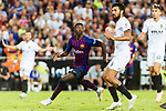 Ousmane Dembele of FC Barcelona (L) in action against Ezequiel Garay of Valencia CF (R) during their La Liga 2018-19 match between Valencia CF and FC Barcelona at Estadio de Mestalla on October 07 2018 in Valencia, Spain. Photo by Maria Jose Segovia Carmona / Power Sport Images