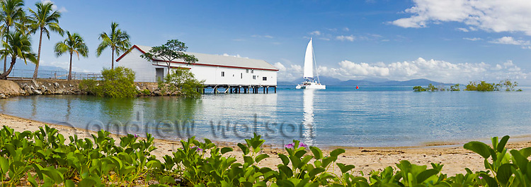 Sailboat passing Historic Sugar Wharf on its way out to the reef.  Port Douglas, Queensland, Australia