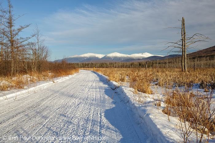 Scenic view of the Presidential Range snow-covered from along the Presidential Range Rail Trail (Cohos Trail) near Cherry Pond at Pondicherry Wildlife Refuge in Jefferson, New Hampshire. This trail utilizes the old railroad bed of the Boston & Maine Berlin Branch, which was abandoned and removed in the 1990s.