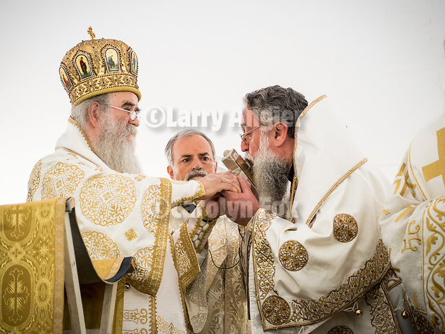 Presentation by Metropolitan Amphilojije to Bishop Longin of a cross made of stone from the boyhood home of St. Mardarije in Montenegro during the Patriarchal Divine Liturgy service with His Holiness Irinej to venerate and glorify the relics of St. Mardarije of Libertyville, St. Sava Monastery Church<br /> <br /> #NGMWADiocese<br /> #GlorificationStMardarije, #Chicago, #PatriarchIrinej, #MetropolitanAmphiloije<br /> #SerbianOrthodoxChurch<br /> #www.stsavamonastery.org