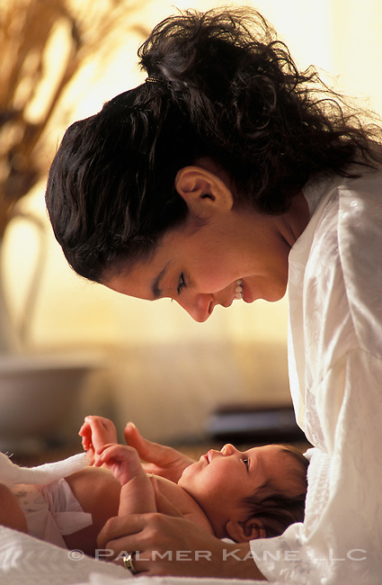 Mom and baby exchanging smiles in bedroom