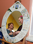Bishop Denis Nulty and local designer Lucy O'Gorman with the mirror she designed for him. Photo:Colin Bell/pressphotos.ie