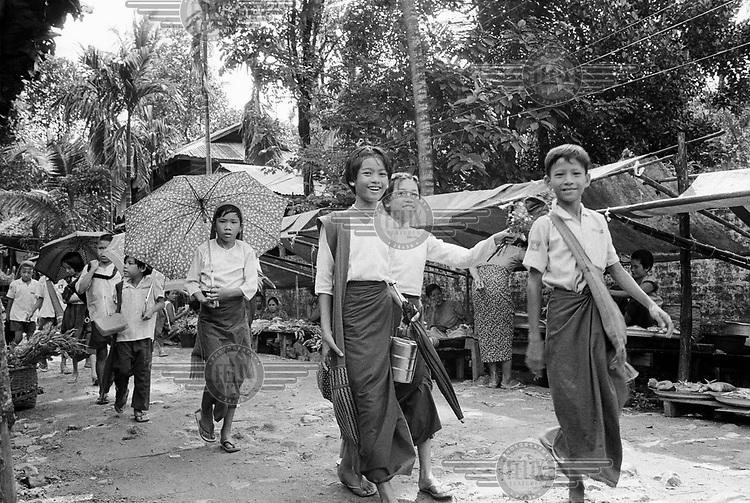 Schoolchildren returning home after lessons.