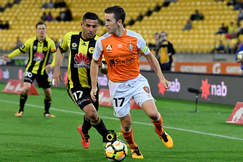 Brisbane's Matt McKay and Wellington Phoenix' Ali Abbas in action during the A League - Wellington Phoenix v Brisbane Roar FC at Westpac Stadium, Wellington, New Zealand on Saturday 28 October.<br /> Photo by Masanori Udagawa. <br /> www.photowellington.photoshelter.com