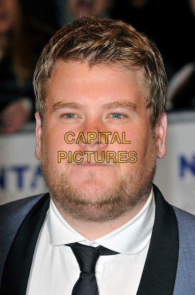 JAMES CORDEN.The 15th National Television Awards held at the O2 Arena, London, England..January 20th, 2010.NTA NTAs headshot portrait black white blue stubble facial hair .CAP/PL.©Phil Loftus/Capital Pictures.