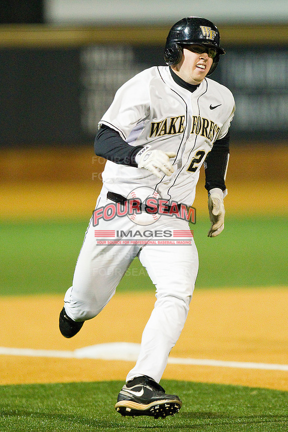 Jack Carey #20 of the Wake Forest Demon Deacons rounds third base against the North Carolina Tar Heels at Gene Hooks Field on March 11, 2011 in Winston-Salem, North Carolina.  Photo by Brian Westerholt / Four Seam Images