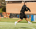 March 19, 2017. Chapel Hill, North Carolina.<br /> <br /> Mitch Trubisky runs through drills on the UNC practice field as he prepares for his Pro Day.<br /> <br /> Mitchell Trubisky, the former quarterback of UNC-CH, is projected to be picked in the first round of the 2017 NFL draft.