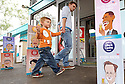 A young boy with his dad spots an eat ice cream advert using a cartoon's of British Prime Minister David Cameron, US President Barack Obama and other G8 leaders outside a petrol station close to the G8 Summit in Lough Erne, Northern Ireland, Britain, 18 June 2013. Leaders from Canada, France, Germany, Italy, Japan, Russia, USA and UK are meeting at Lough Erne in Northern Ireland for the G8 Summit 17-18 June. The leaders were holding their second and final day of talks on 18 June, with the global economy and tax avoidance high on the agenda.  Photo/Paul McErlane