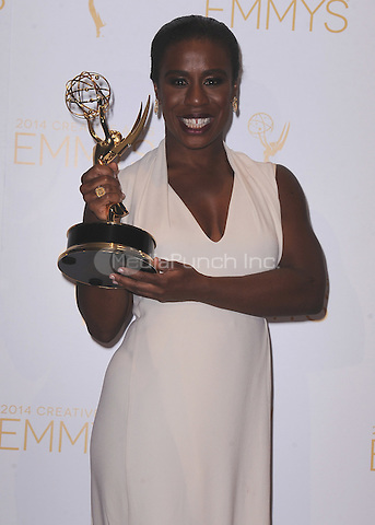 LOS ANGELES, CA - AUGUST 16:  Uzo Aduba in the press room at the Television Academy's 2014 Creative Arts Emmy Awards at the Nokia Theatre L.A. Live on August 16, 2014 in Los Angeles, California. PGKirkland/MediaPunch