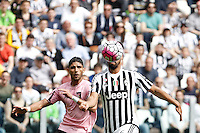 Calcio, Serie A: Juventus vs Palermo. Torino, Juventus Stadium, 17 aprile 2016.<br /> Juventus&rsquo; Sami Khedira, right, prepares to score as he is challenged by Palermo's Achraf Lazaar during the Italian Serie A football match between Juventus and Palermo at Turin's Juventus Stadium, 17 April 2016.<br /> UPDATE IMAGES PRESS/Isabella Bonotto