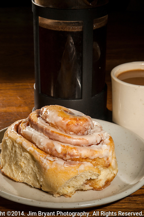 """Cafe Gabielle's """"Peggy's Cinnamon Roll"""" with French pressed freshly grounded Ethiopian Harrar coffee . ©2014. Jim Bryant Photography. All Rights Reserved."""