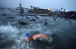 OCEANSIDE, CA - MARCH 31:  General view of a competitors entering the water  in the California Ironman 70.3 on March 31, 2012 in Oceanside, California. (Photo by Donald Miralle).