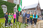 GREEN FLAG: Presentation Primary School Tralee got their fourth Green Flag which was raised by Kerry footballer Colm Cooper on Thursday last, pictured are Tammy O'Shea, Charlotte O'Halloran, Pat Sayers, Principal, Sarah Cleary, Jessica Stephenson, Angela Wall, Colm Cooper , Lauren Foley, Maya Fitzpatrick, Andrea Gergely and Megan Arnopp.