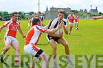 Kieran Shanahan (Ardfert) in action with Peter Curtin (Brosna) in the County League on Sunday at Ardfert GAA Grounds.