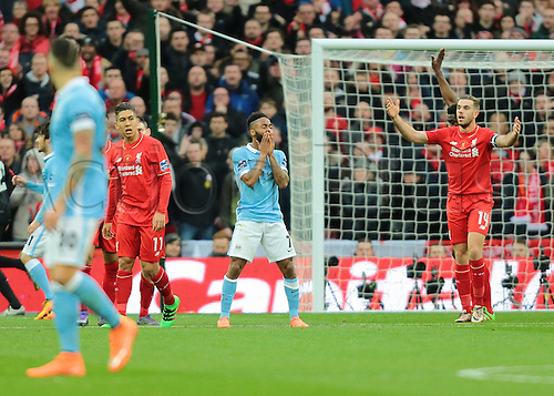 28.02.2016. Wembley Stadium, London, England. Capital One Cup Final. Manchester City versus Liverpool. Manchester City Midfielder Raheem Sterling holds his face after missing a goal scoring opportunity