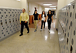 (09/18/17 Springfield MA) Thomas Mazza, principal of the Forest Park Middle School,  walks in the hallway with students, from left, Ariana Figueroa, Xiomareliz Rivera and Yeseliz Ortiz, Monday, Sept. 18, 2017, in Springfield. Herald Photo by Jim Michaud