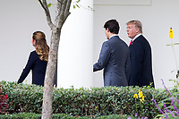 United States President Donald J. Trump and the Prime Minister of Canada Justin Trudeau walk to the Oval Office of the White House led by First Lady of the United States Melania Trump and Trudeau's wife Sophie Gr&Egrave;goire on October 11th, 2017 in Washington, D.C. <br /> CAP/MPI/RS<br /> &copy;RS/MPI/Capital Pictures