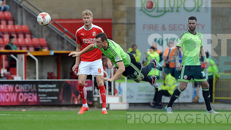 Neill Collins of Sheffield United is challenged by Michael Smith of Swindon Town<br /> - English League One - Swindon Town vs Sheffield Utd - County Ground Stadium - Swindon - England - 29th August 2015 <br /> --------------------