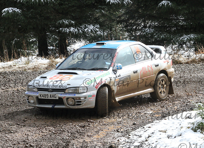 Geoff Goudie - Chris Robertson in a Subaru Impreza at Junction 6 on Special Stage 1 Riccarton on the Brick & Steel Border Counties Rally 2014, Round 2 of the RAC MSA Scottish Rally Championship sponsored by ARR Craib Transport Limited and other championships  and organised by Whickham & District and Hawick & Border Car Clubs and based in Jedburgh and held in Kielder Forest on 22.3.14.
