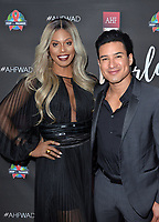 LOS ANGELES, CA- NOV. 30: Laverne Cox, Mario Lopez at the 30th Anniversary AIDS Healthcare Foundation Concert at the Shrine Auditorium in Los Angeles on November 30, 2017 Credit: Koi Sojer/Snap'N U Photos/Media Punch