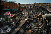 Daily wage labourers fill up the lorry of coal in Goladi coal depot in Jharia, outside of Dhanbad in Jharkhand, India.  Photo: Sanjit Das/Panos