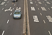 Cars driving down Chinese road