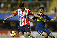 "BUENOS AIRES - ARGENTINA - 04 - 04 - 2018: Cristian Espinoza (Der.) jugador de Boca Juniors disputa el balón con Jorge Arias (Izq.) jugador de Atletico Junior, durante partido de la fase de grupos, grupo H, fecha 2, entre Boca Juniors (ARG) y Atletico Junior (Col) por la Copa Conmebol Libertadores 2018, jugado en el estadio Alberto J. Armando ""La Bombonera""  de la ciudad Ciudad Autónoma de Buenos Aires. / Cristian Espinoza (R) player of Boca Juniors vies for the ball with Jorge Arias (L) player of Atletico Junior, during a match of the groups phase, group H, of the 2nd date between Boca Juniors (ARG) and Atletico Junior (Col), for the Copa Conmebol Libertadores 2018 at the Alberto J. Armando ""La Bombonera"" Stadium in Ciudad Autónoma de Buenos Aires. Photo: VizzorImage / Javier Garcia Martino / Photogamma / Cont."