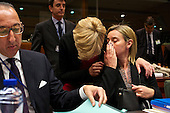 High Representative of the European Union for Foreign Affairs and Security Policy Federica Mogherini speaks to a colleague during a meeting at the EU Council on migration.