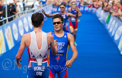 25 AUG 2012 - STOCKHOLM, SWE - Javier Gomez (ESP) of Spain (right) congratulates Jonathan Brownlee (GBR) of Great Britain (left) for winning the elite men's 2012 ITU World Triathlon Series round in Gamla Stan, Stockholm, Sweden (PHOTO (C) 2012 NIGEL FARROW)
