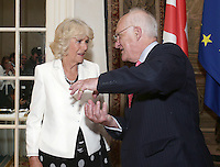17 May 2016 - London, England - Camilla Duchess of Cornwall speaking to Selwyn Image, founder of Emmaus UK, at a reception to celebrate the 25th anniversary of the charity - which supports former homeless people by giving them a home within one of its Emmaus Communities - at the French Ambassador's Residence in Kensington, London. Photo Credit: ALPR/AdMedia