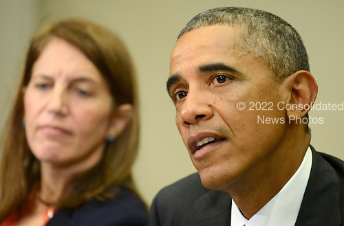 United States President Barack Obama (R) makes remarks as US Secretary of Health and Human Services Sylvia Burwell listens during a meeting with his national security team and senior staff for an update on the Ebola crisis in West Africa, at the White House, October 6, 2014, in Washington, DC.<br /> Credit: Mike Theiler / Pool via CNP