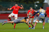 29th February 2020; Thomond Park, Limerick, Munster, Ireland; Guinness Pro 14 Rugby, Munster versus Scarlets; Chris Farrell of Munster is tackled by Paul Asquith and Sam Lousi of Scarlets